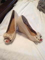 Cream Wedges size 8.